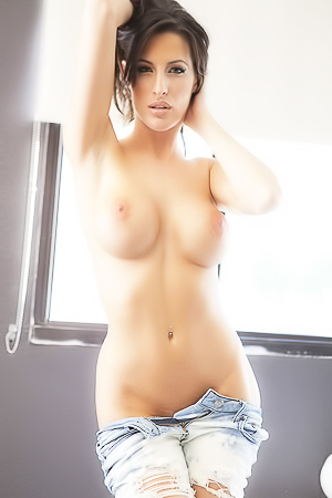 Busty model Kortney Kane in jeans