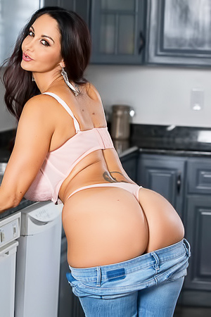 Sexy brunete in tight blue jeans