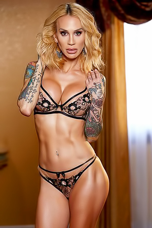 Tattooed And Sporty MILF Sarah Jessie