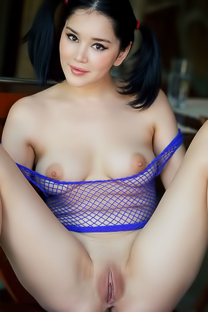 Malena - Sexy beauty with pig-tails and a pretty bod