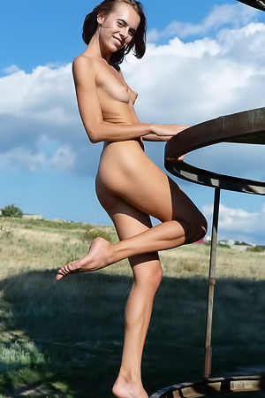 Gracie - Fun, skinny babe gets naked and climbs around outside