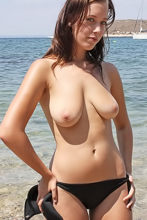 Busty Danielle topless on the shore